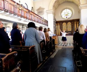 Helen Astrid leading the LBRUT choir rehearsal